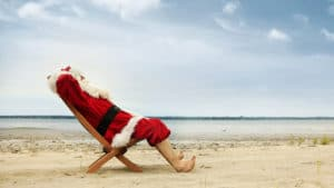Santa Lounging on Beach
