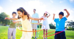 kids hoola hooping in field