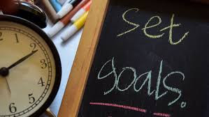 set goals written on chalkboard