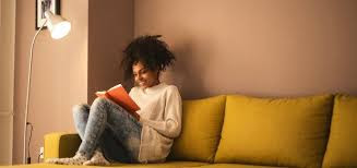 Woman reading a book on couch